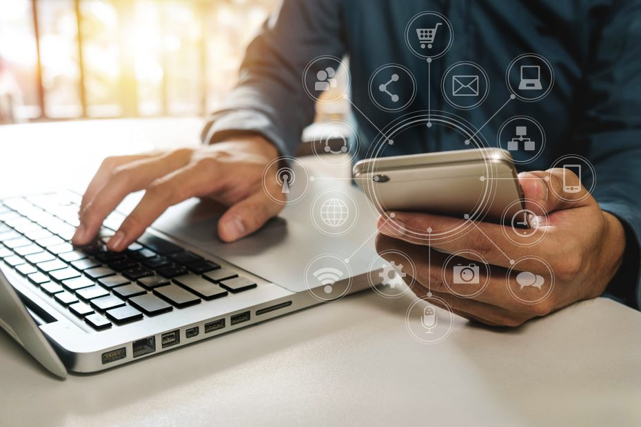 AdobeStock_165249622 930x620 close up of hand using tablet ,laptop, and holding credit card